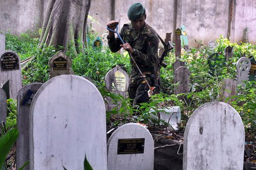 The remains of a suicide bomber who attacked a church in eastern Sri Lanka on Easter Sunday have been exhumed after protests demanding they be moved from a local cemetery.