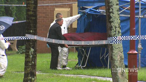 Two more men charged over body found in surfboard bag at Wollongong unit block in April