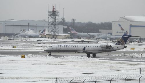 Flights were grounded, 300,000 were without power and schools and businesses were closed.
