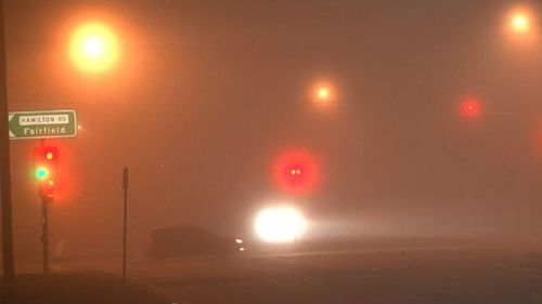 Fog blankets the road in Fairfield in Sydney's west. (9NEWS)
