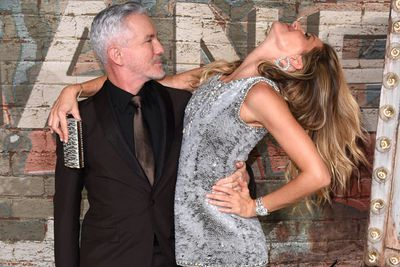 A little party never killed nobody... which is why Gisele's tossing her hair back with Baz.