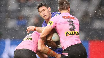 Penrith's defence takes care of Nick Meaney of the Bulldogs at Bankwest Stadium.