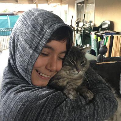 Jo Abi and son Philip hugging Leo