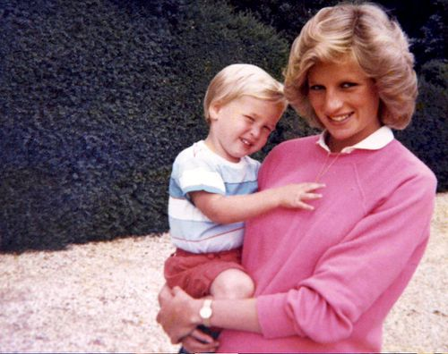 Princess Diana holds Prince William while pregnant with Prince Harry. (Kensington Palace)