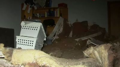 Bedroom ceiling collapses on man getting ready for work