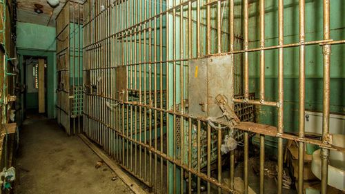 The original prison cells with barred windows and the jailer's office remain.
