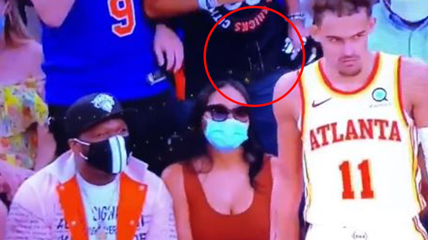 The Knicks said they banned a fan from Madison Square Garden for spitting on Atlanta guard Trae Young