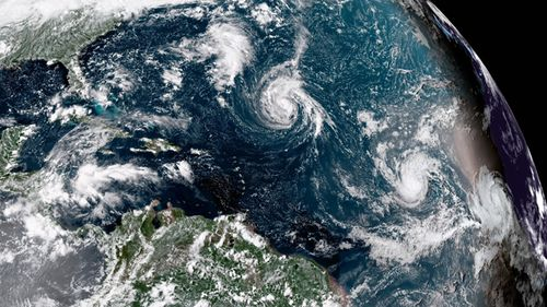 Enhanced satellite image made available by NOAA shows Tropical Storm Florence, center, in the Atlantic Ocean on September 8, 2018. (AAP)