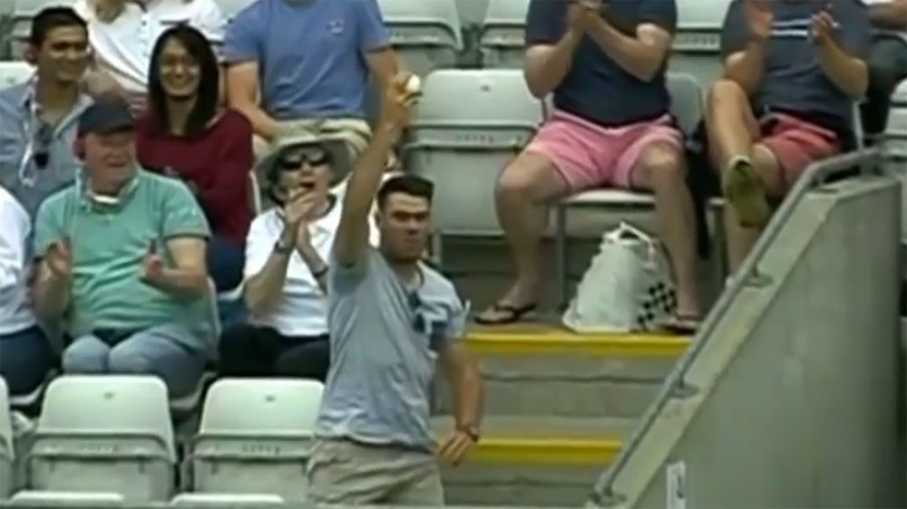 Cricket fan takes classic catch during Australia, New Zealand Champions Trophy washout