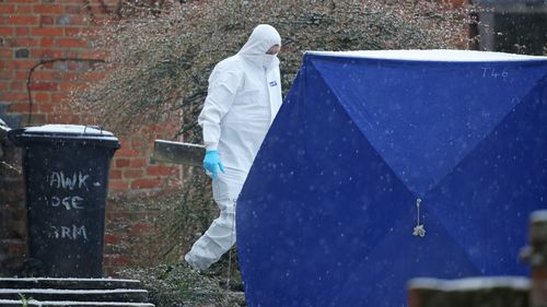 Forensic police outside the Meadows' home.