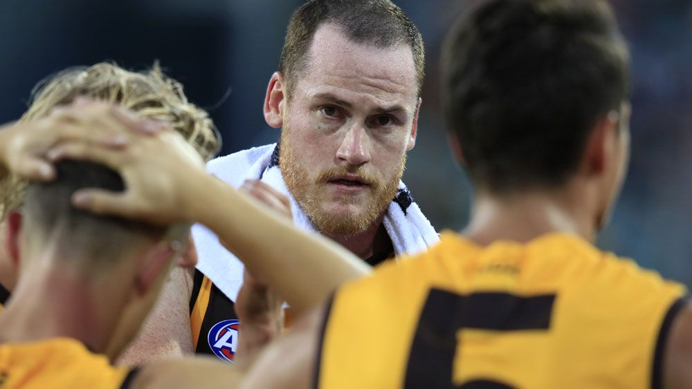 Hawks grab late AFL trial win over Cats as Roughead returns