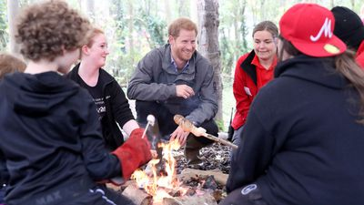 """Prince Harry sits around campfire on royal visit<span style=""""white-space: pre;""""></span>"""