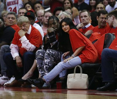 Travis Scott and Kylie Jenner make their first public appearance together at the NBA Playoffs in Texas, April 2017