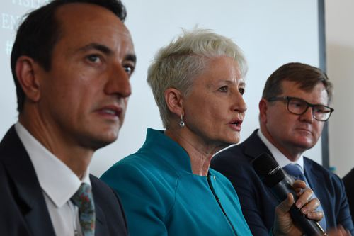 Kerryn Phelps, centre, with David Sharma, left, and Labor's Tim Murray in a debate at Bondi Surf Club on Monday.