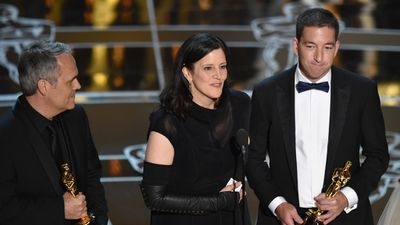 <b>Best Documentary Feature:</b><br><br>Dirk Wilutzky, Laura Poitras and Glenn Greenwald accept their award for 'Citizenfour'. (AAP)