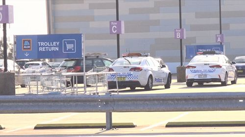 Police cars parked on the top level of Westfield Eastgardens where the carjacking took place.