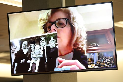 Gillian Millane holds a family photograph during her televised victim impact statement from her home in the UK. The 28-year-old man was found guilty of the murder of British backpacker Grace Millane, whose body was found in bush in West Auckland's Waitakere Ranges on 9 December 2018. Jurors at Auckland's High Court took about four hours to convict him in November 2019