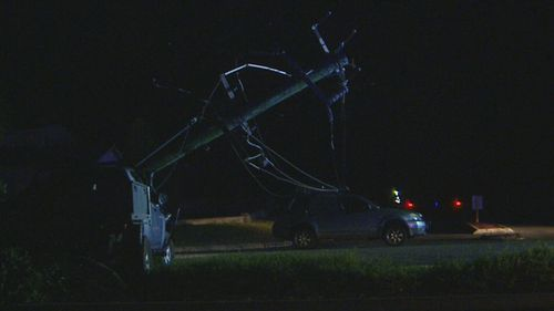 The female driver and her young son were trapped in their car under live powerlines for 30 minutes.