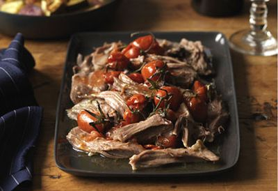 Slow-cooked lamb shoulder with roast vegetables