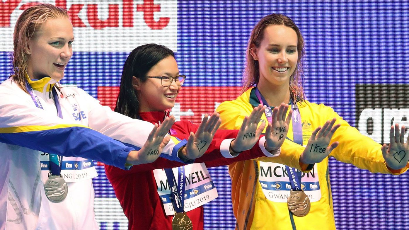 World swimming championships women's 100-butterfly gold medalist Margaret MacNeil (C) of Canada, silver medalist Sarah Sjoestroem (L) of Sweden and bronze medalist Emma McKeon of Australia