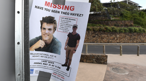 A missing persons flyer is seen near a beach as the search continues for missing backpacker Theo Hayez at Byron Bay on the far north New South Wales coast, Thursday, June 20, 2019.  (AAP Image/Dave Hunt)