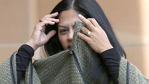 Geecy Rebucas arrives at court where her former boyfriend Roy Tabalbag is on trial for the murder of her lover Amin Sthapit in 2013. (AAP)