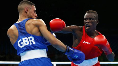 Galal Yafai of Great Britain (left) competes against Simplice Fotsala of Cameroon in their men's light fly 46-49kg preliminary bout. (Getty)