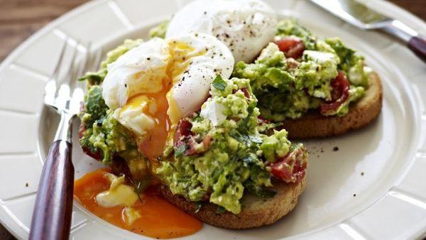 Poached eggs with avocado and feta smash on sourdough