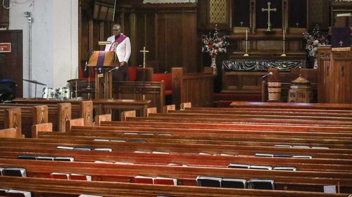 Reverend Janet Cox, a deacon at St. Paul's Methodist Church in Brooklyn, New York, delivers her sermon from an empty church to home-bound congregants by a livestream broadcast.