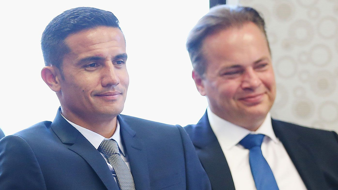 Tim Cahill (left) and Mark Bosnich