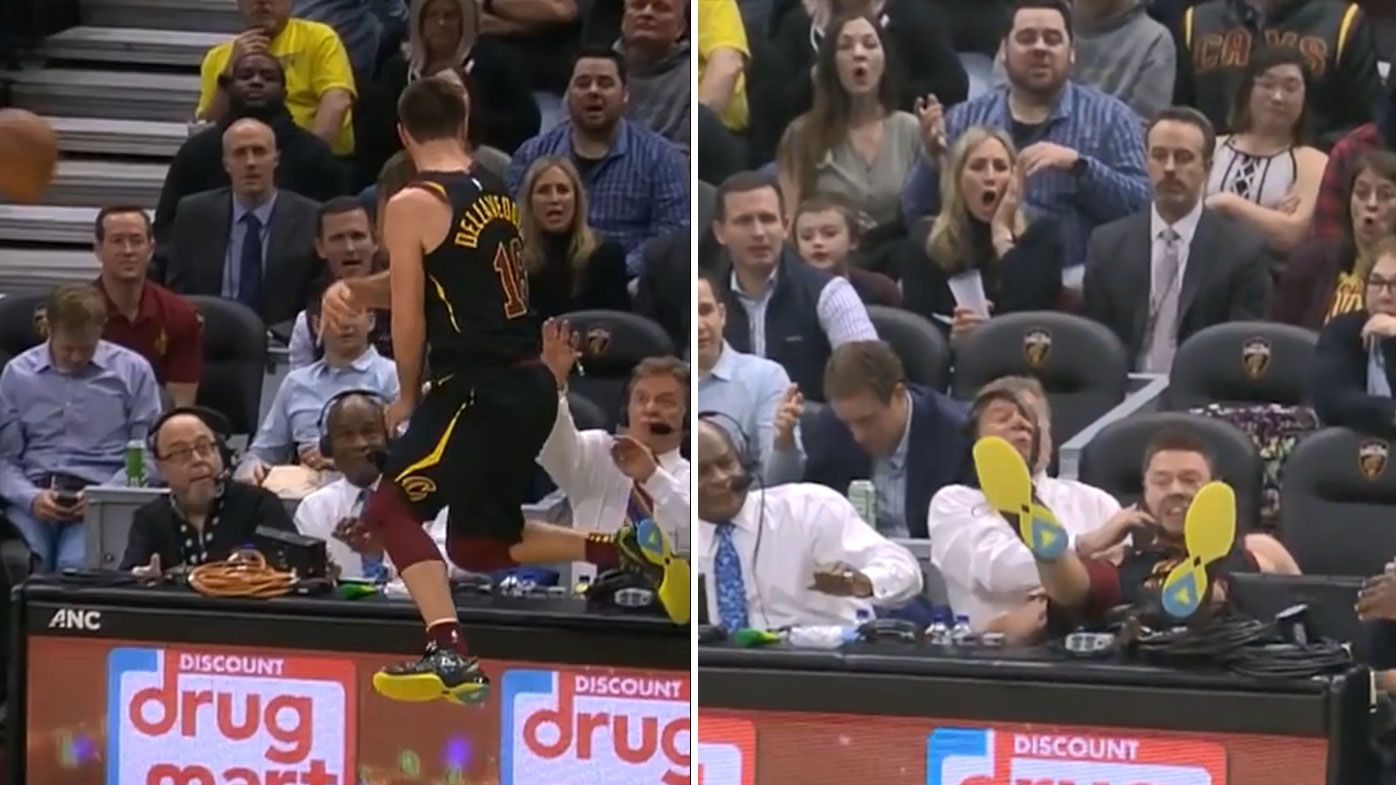Matthew Dellavedova inadvertently takes out NBA commentator with incredible diving effort