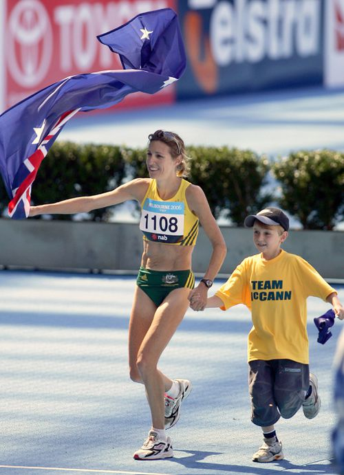 Kerryn McCann celebrates with her son Brenton, 9, after winning gold in the Women's Marathon at the Melbourne Cricket Ground at the Commonwealth Games in 2006. Picture: AAP