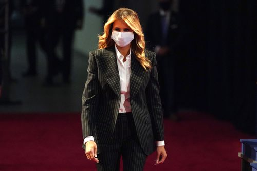 First lady Melania Trump, wearing a facemask, walks towards her seat for the during the first presidential debate