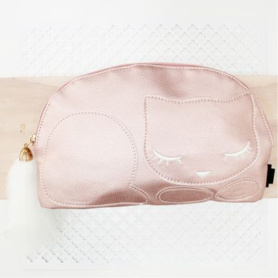 """<a href=""""https://www.pavementbrands.com/item/016324-sleeping-kitty-pencilcase.html?colour=rose+gold"""" target=""""_blank"""">Pavement Sleeping Kitten Pencilcase, $19.95.</a>"""