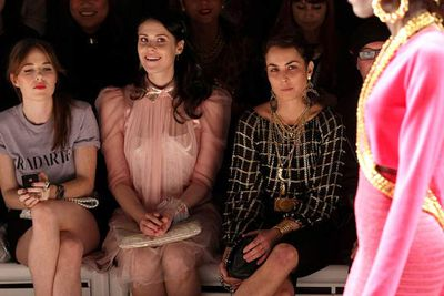 Kate Nash and Noomi Rapace assess an outfit critically.