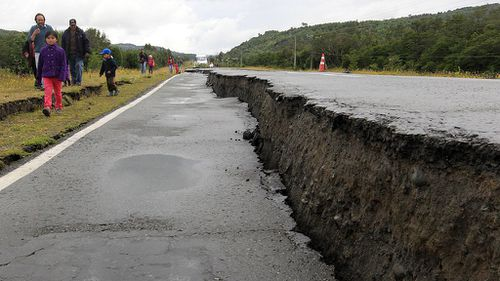 Some roads and at least one bridge were damaged in Quellon, located on Chiloe Island. (AAP)
