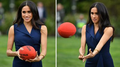 Meghan gives Aussie Rules a crack