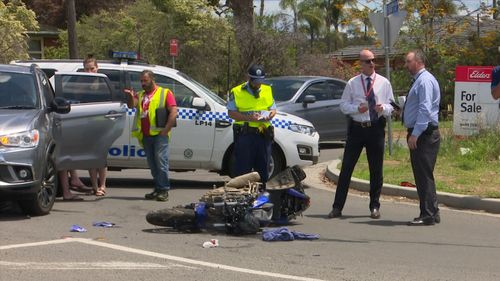 A motorcycle rider has fled after smashing into a four-wheel drive.
