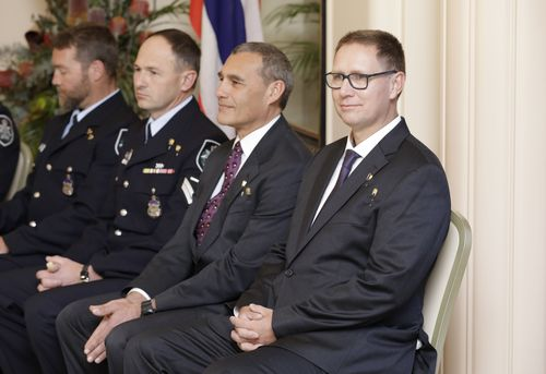 Dr Harris (right) and rescue partner Craig Challen (second from right) have already received the Order of Australia and the Star of Courage by Governor General Peter Cosgrove.