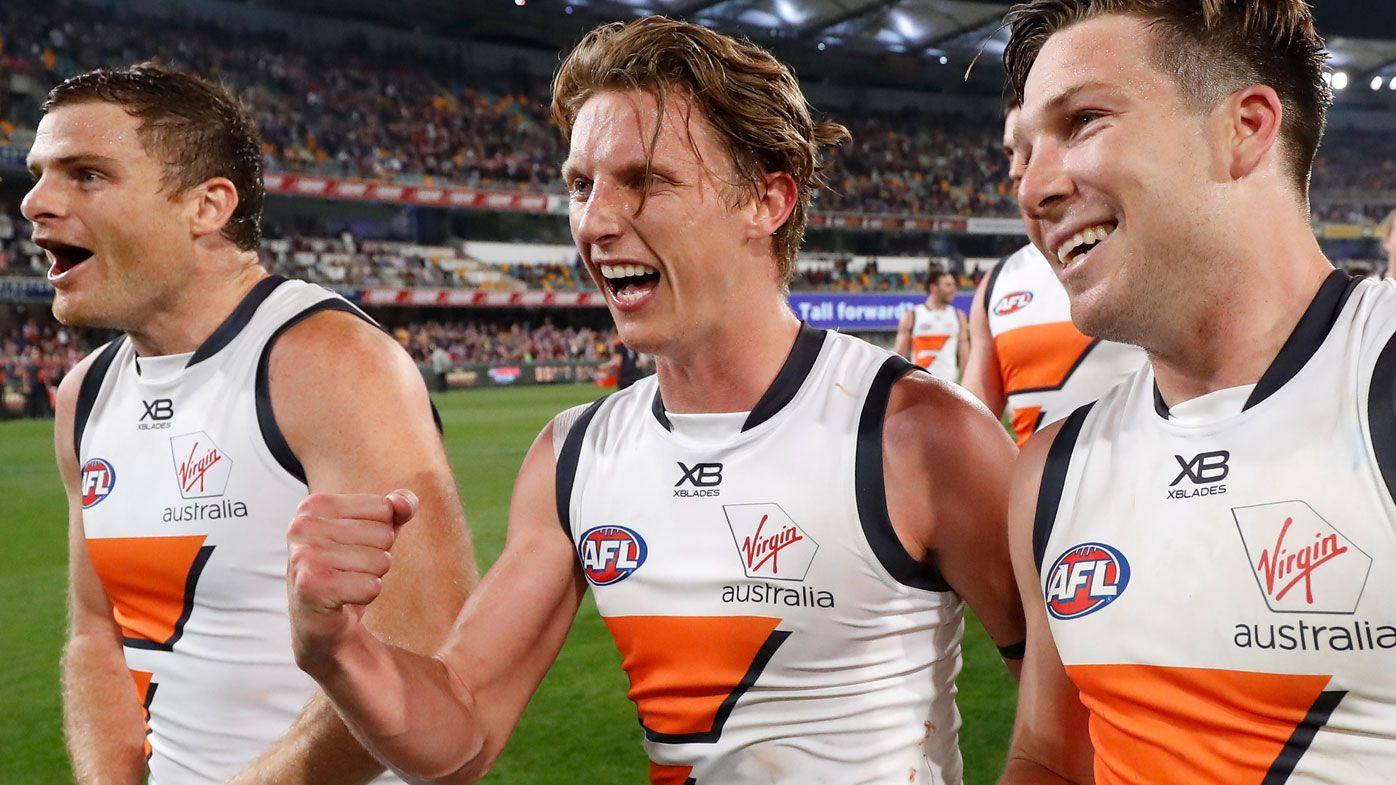Heath Shaw, Lachie Whitfield and Toby Greene of the Giants celebrate during the 2019 AFL Second Semi Final