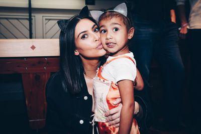 Meow mama: Kim K with daughter North West with kute kitty headbands.
