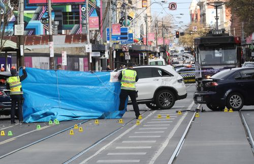 The 27-year-old cyclist was travelling in a bike lane in South Yarra's Chapel Street when she was struck by a white Mercedes-Benz and knocked into the path of another car on Sunday.