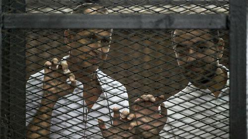 Al-Jazeera channel's Australian journalist Peter Greste and Egyptian journalist Mohamed Baher. (Getty Images)