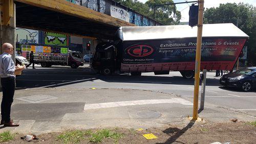 Truck wedged under Melbourne CBD overpass
