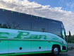 A woman made a frantic call to police from the luggage compartment of a moving bus after being locked in there by the woman driver.