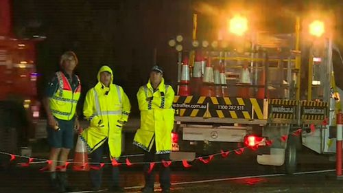 The car struck the man when it crashed through overnight roadworks. (9NEWS)