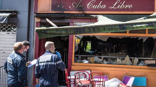 Police inspect the scene of the tragedy in Rouen. (AAP)