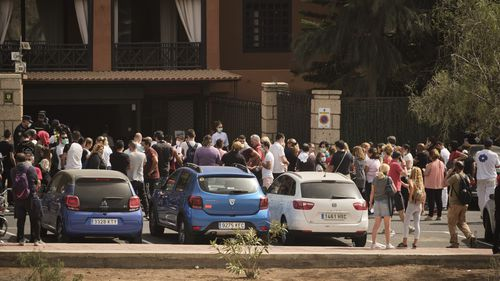 Hotel workers queue to get tested at the H10 Costa Adeje Palace hotel in the Canary Island of Tenerife, Spain.