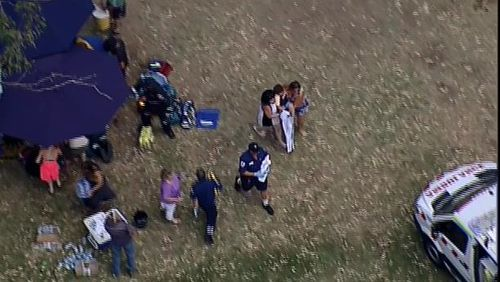 A victim is carried to a waiting ambulance after the explosion. (9NEWS)
