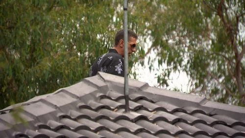 The 33-year-old accused thief climbed onto a roof of a family's home.